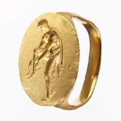 Gold finger ring engraved with an image of Hermes  Period: Late Classical Date: late 4th century B.C. Culture: Greek, South Italian, Tarentine Medium: Gold Dimensions: Overall: 13/16 x 7/16in. (2 x 1.1cm)