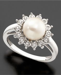 Pristine style with a pretty setting. This lovely ring features a beautiful cultured freshwater pearl (8-8.5mm) and round-cut diamond accent set in 10k white gold. | Photo may have been enlarged and/o