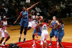 Jessica Adair ('09), leaping to block the shot in this photo, came back to the Verizon Center with the Minnesota Lynx last night to take on the WNBA's Washington Mystics. She added 4 points in 11 minutes in front of hometown fans.