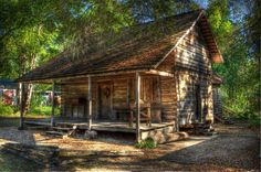 This 1870 Rufus Smith Log House is not a memory but a testimony of our past and our roots... This dogtrot style log house was built by Rufus Smith and his wife Cecilia. Five miles outside of what today is Coolidge in the northeast corner of Thomas County, the three-room house sat on a 504 acre farm and housed Rufus, Cecilia, and at various times their thirteen children