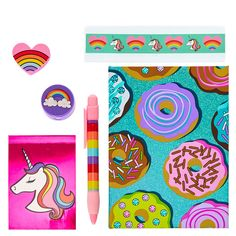 Rainbows, and donuts, and unicorns,  oh my! No boring school supplies here, this stationery set is made of magic.   It includes  glittery green notebook with a donut print, a small purple notepad decorated with a unicorn, a purple pencil sharpener with a rainbow, a pink heart with a rainbow, a thick rainbow striped pen, and a 6 inch ruler decorated with hearts and unicorns.