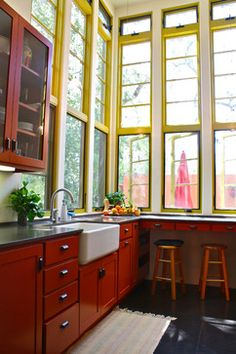 yellow kitchen window frames, farmhouse sink, cherry cabinets- love the tall windows Red Kitchen, Kitchen Interior, Happy Kitchen, Eclectic Kitchen, Nice Kitchen, Awesome Kitchen, Quirky Kitchen, Kitchen Corner, Kitchen Modern