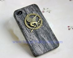The hunger games Mockingjay Iphone case, Black Wood Iphone 4 case, Iphone 4S case, Hard Plastic Iphone CASE. $10.99, via Etsy.
