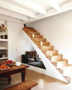 Cozying up in this hidden nook under the staircase. | 31 Places Bookworms Would Rather Be Right Now