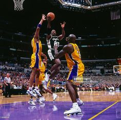 Jerome Kersey #25 of the San Antonio Spurs drives to the basket against the Los Angeles Lakers circa 2000 at Staples Center in Los Angeles, CA.