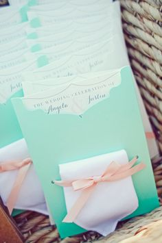 Ceremony programs tucked into mint #envelopes and embellished with blush bows. {The Nichols Studio}