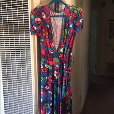 Floral dress. Size large. So soft! Not sure fabric Flower print wrap around dress. Spinny and flowy. Super soft and never been worn. It looks like it could fit a small person and a fuller woman. I am the latter and when I tried it on it fit, just never wore it. Jaloux Dresses Midi
