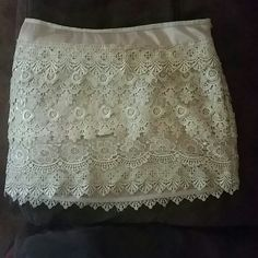 Beautiful lace skirt Boutique cream lined lace skirt. Size small. Alythea Skirts