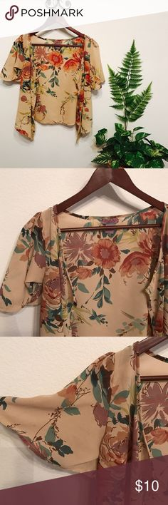 Chiffon cardigan Sheer and tan with floral pattern, it is polyester and in good condition.☺️ Tops