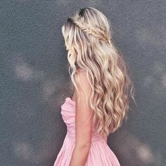 @carajourdan is the ultimate Girl Next Door in a pink sweetheart dress and a twisted half up crown braid . She finishes off with loose beach waves to add a flirty touch to her sweet look . #hairoftheday #NuMeStyle #braid