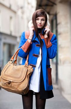 Choose a blue toggle coat and a black sleeveless coat to create a chic, glamorous look.  Shop this look for $155:  http://lookastic.com/women/looks/tights-satchel-bag-duffle-coat-sheath-dress-sleeveless-coat/6872  — Black Tights  — Tan Leather Satchel Bag  — Blue Duffle Coat  — White Sheath Dress  — Black Sleeveless Coat