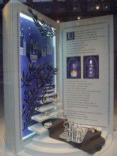 Open storybooks lend a fantasy like feel to this display. Color and details make this more than a retail display. It makes it a work of art! Pop Display, Visual Display, Display Design, Booth Design, Store Design, Shop Window Displays, Store Displays, Museum Displays, Cire Trudon