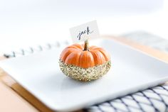 These mini pumpkin placecards are sure to add some sparkle to your Thanksgiving table. We guarantee guests won't be able to stop talking about how cute they are—after they're done complimenting your amazing cooking skills, that is. Get the instructions at Best Friends of Frosting.   - WomansDay.com