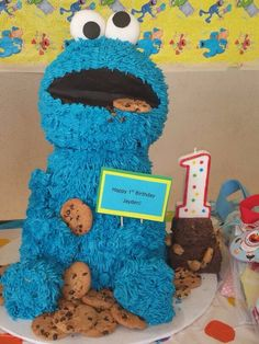 Cookie Monster cake at a Sesame Street, Elmo Birthday Party!   See more party ideas at CatchMyParty.com!  #partyideas #sesamestreet