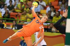Netherlands' centre back Nycke Groot jumps to shoot during the women's Bronze Medal handball match Netherlands vs Norway for the Rio 2016 Olympics Games at the Future Arena in Rio on August / AFP / afp / Roberto SCHMIDT Women's Handball, Handball Players, Rio Olympics 2016, August 20, Garra, Rio 2016, Schmidt, Sports Women, Athletes