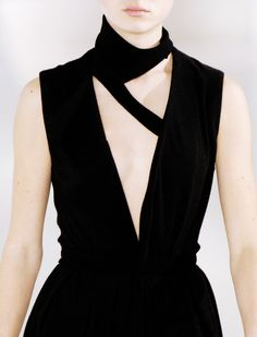 Black dress with triangle cutouts; bold geometric fashion details