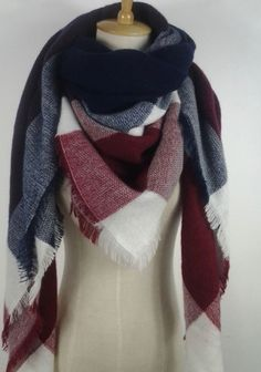 This extra soft scarf is perfect to keep you warm and stylish the whole winter and fall season. This scarf is plaid with red, navy blue, and white. Size: 55 inches by 55 inches