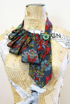 Repurposed tie. But what I really love is that dress form covered in old book pages!