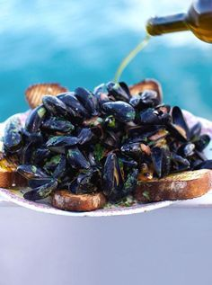 Creamy mussels with smoky bacon & cider sauce with garlicky toast for mopping up the lovely sauce. This boozy mussels recipe makes the most amazing fragrant sauce – don't be shy with the toast!