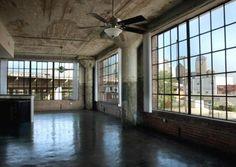 big windows, concrete columns, shiny floor. I dig it.