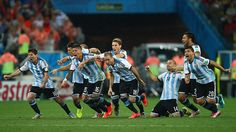 The Argentina team react after beating Holland on penalties