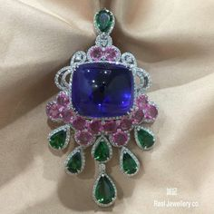 @anna_shia.  Sugarloaf Tanzanite,Pear Tsavorite,Round Pink Sapphire with Diamonds pendant。誠記 Real Jewellery co.。