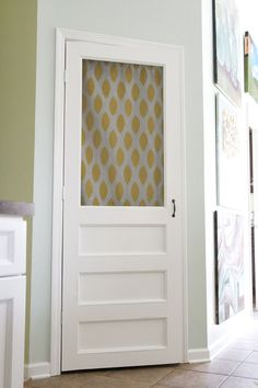 Screen door for the pantry with a curtain.  And these folks built it themselves.  Wow!