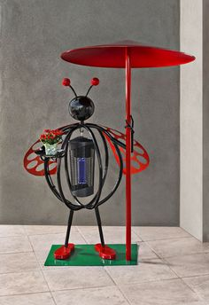 Lady BugMe by Kevin Caron contains a bug zapper in her belly.