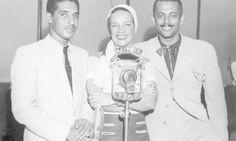 Carmen Miranda entre Dorival Caymmi e Assis Valente: três dos principais nomes da Era do Rádio