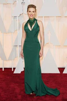 Scarlett Johansson makes a bold statement in her emerald green Versace gown at the Academy Awards.   #Oscars #Oscars2015