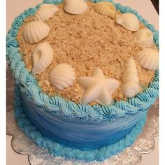 Do you make your kids birthday cakes? I made this cake for my daughter's under the sea birthday party. Topped with crumbled Nilla cookies and chocolate seashells. Super easy and pretty! Birthday Cakes Girls Kids, Bday Girl, Beach Cake Birthday, Cake Kids, Ocean Cakes, Beach Cakes, Fete Emma, Cake Simple, Lorie