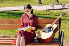 Beautiful young woman reading book on bench in park - Stock Photo , #ad, #woman, #reading, #Beautiful, #young #AD