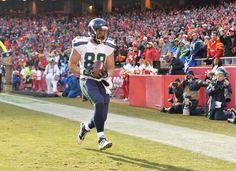 Recap Week 11: Tony Moeaki #88 of the Seattle Seahawks scores a touchdown against the Kansas City.