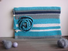 Blue striped crochet clutch with flower by mixandmatchEledesign