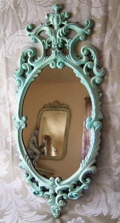 Shabby Aqua Beach Cottage Ornate Wall Mirror Medium Pastel Oval Hollywood Regency Victorian. $25.00, via Etsy.