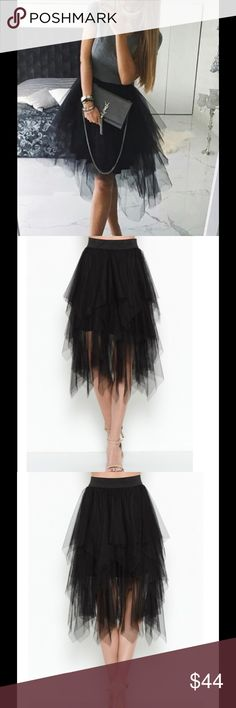 Mesh Tiered Skirt - Black This skirt features a tiered design of cascading layers with an asymmetrical cut. Elastic waist band. Skirts Asymmetrical