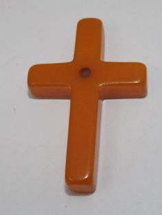 Vintage Orange Bakelite Cross