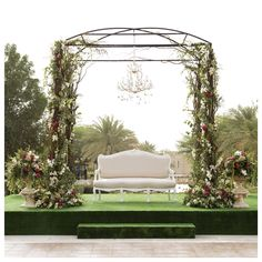 Garden inspired wedding stage. Gazebo decorated with flowers and flanked with urns of blooms