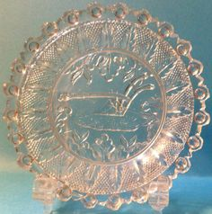 "Lee & Rose 689 Plow Cup Plate - Flint - Sandwich Glass - VERY RARE  Pictured on AGCP Plate 109.  Described on AGCP page 374.  3-7/16"" diameter, 24 bull's eyes with points between.  Condition:      A few missing &/or tipped points.      Several nicked &/or chipped scallops.      All bull's eyes are intact.      A couple of edge anomalies at 9:30 & 10:30, but they are NOT flakes, just a dip & a raised spot.  SOLD $50.99 from Peterborough, NH"