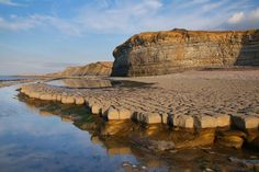 Limestone ledges at low tide, St Audries Bay, West Quantoxhead, Somerset, England