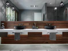 Designed by MR. MITCHELL, this bathroom in Portsea features a natural and organic palette of timber and stone.