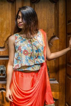 A summery flowy crop top in a kalamkari crepe fabric. Subtle shimmer detailing captures summertime magic with a kalamkari twist!Pair it with skirts or pair it with palazzos. Cropped in a short length which can be paired with a saree too! #kalamkari #saree #india #blouse #houseofblouse