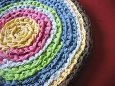 "t shirt crocheted rug.  I was intrigued by the ""layered"" look and though the blog author didn't know what she did, other crocheters did:  she did a single crochet through only the back loops.  Very pretty design!"