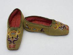 Child's Berlin work wool slippers, circa 1840.