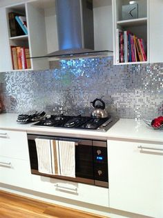 This sparkly backsplash is boss... But I also love having a picture of the cookbook cubbies Joe and I have been talking about putting in over the stove!