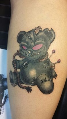 Voodoo doll, teddy bear, tattoo