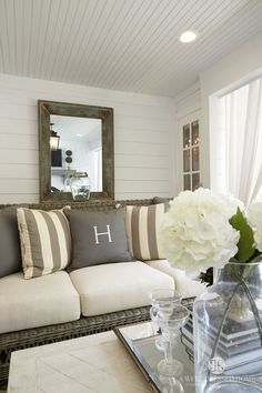 Shiplap walls and beadboard ceiling in the outdoor living room