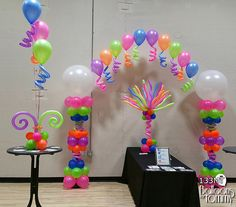 Neon balloons, a balloon arch, balloon centerpieces, and squiggles! Balloon Tower, Balloon Columns, Balloon Arch, Balloon Garland, Rainbow Party Decorations, Birthday Decorations, Party Themes, Party Ideas, Balloon Arrangements