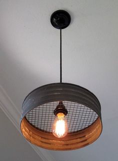 Metal Sifter Pendant Light What a great light! Made with a grey corrugated metal that looks just like it came from an old farmhouse. This would make a great addition to a kitchen, laundry room, mudroom, barn, etc. The diameter Rustic Kitchen Lighting, Kitchen Lighting Fixtures, Farmhouse Lighting, Rustic Farmhouse, Kitchen Rustic, Kitchen Industrial, Farmhouse Style, Industrial Style, Cheap Kitchen