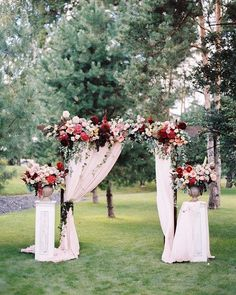 deep red and blush wedding floral archway / http://www.deerpearlflowers.com/wedding-ceremony-arches-and-altars/3/
